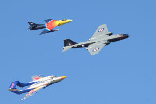 a Canberra, Hunter, and Sea Vixen flying in V formation.
