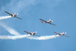 a quartet of Yaks, in diamond formation trailing smoke